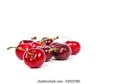Fresh ripened red cherries over white background