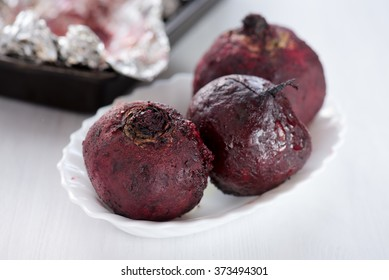 Fresh roasted beetroot served in the aluminum foil in the plate