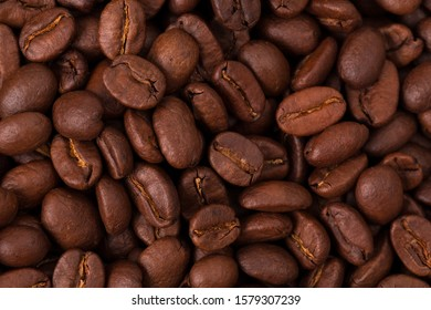 fresh Roasted coffee beans closeup. Background textured