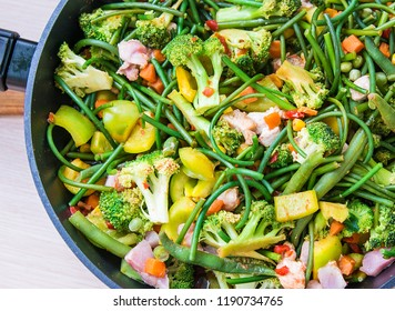 fresh roasted vegetables. pepper, garlic broccoli, arrows and lots of peas. a beautiful mix of vegetables. healthy eating