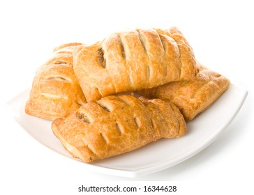 Fresh rolls on a plate on a white background