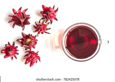 Fresh Roselle and cup of hot organic Roselle tea for a healthy drink on white background. Top view
