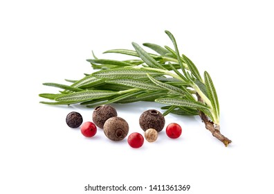 Fresh rosemary with pepper assorted  in closeup on white background