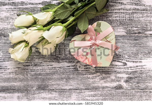 Fresh roses flowers with heart on gray painted wooden background. Place for text. Post card, greeting card mock up.