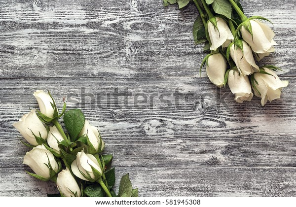 Fresh roses flowers on gray painted wooden background. Place for text. Post card, greeting card mock up.