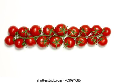 Fresh row of vine tomatoes isolated on white