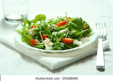 Fresh ruccola salad with baked pumpkin and goat cheese
