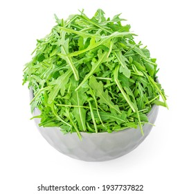Fresh Rucola in a bowl isolated on white background. Rocket salad or arugula, healthy dieting concept