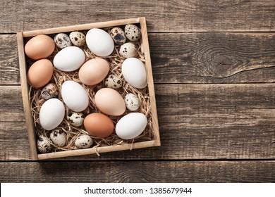 Fresh rustic eggs in wooden box