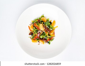 fresh salad with arugula, tomato, pepper and mandarin. - Image