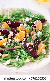 fresh salad beetroot, arugula, mandarins, cheese