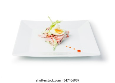 Fresh salad with boiled egg, meat and vegetables isolated on white background