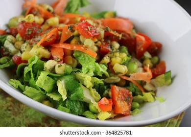 Fresh salad in a bowl on a green napkin close up