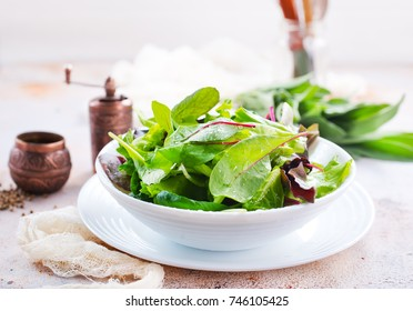 fresh salad in bowl and on a table