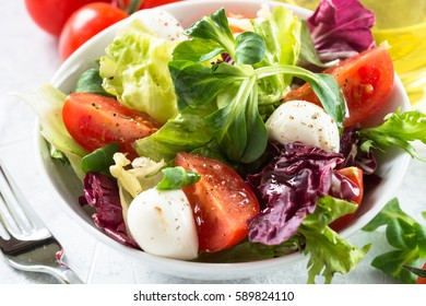 Fresh salad in a bowl. Organic food. Close up.