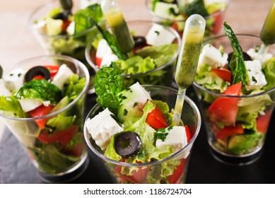 Fresh salad with cheese and tomato in a glass. catering food background