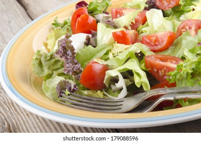 fresh salad with cherry tomatoes on a plate