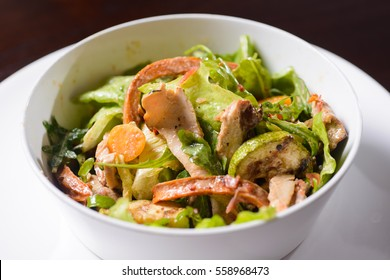 Fresh salad with chicken breast, zucchini and tomatoes.