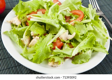 fresh salad with chicken and tomatoes