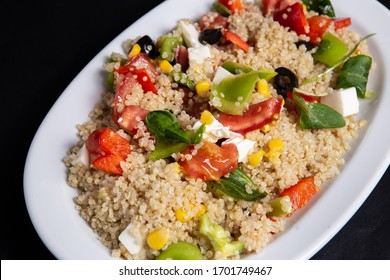 Fresh salad with couscous and vegetables. Best nutritious food for dieting and slimming. Source natural vitamins and minerals