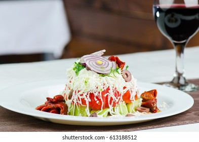 Fresh Salad With Cucumber, Tomatoes, White Cheese, Grilled Pepper, Onion And Glass Of Red Wine