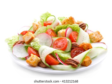 Fresh salad of cucumbers, radishes ,  chinese cabbage ,tomatoes ,pecans and croutons.Healthy food, diet nutrition