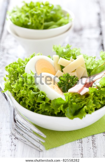 fresh salad with egg and ham