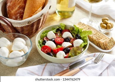 fresh salad with feta cheese and olives