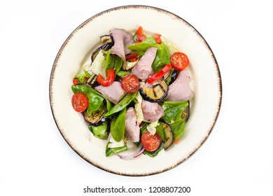 Fresh salad with ham, red pepper, eggplant and basil leaves, tomato isolated on a white background