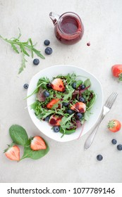 Fresh salad with lettuce, berries and blueberry vinaigrette