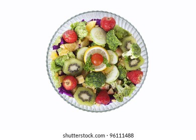 A fresh salad made of fruits and vegetables in the bowl, isolated on white