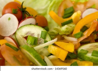 Fresh salad made of vegetables like tomatoes or cucumbers