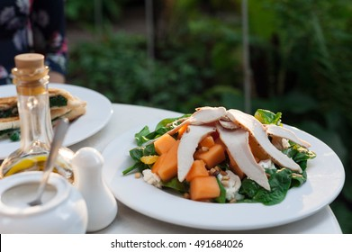 Fresh salad made of watermelon, pumpkin, grilled chicken and fresh salad leaves
