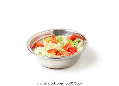 fresh salad in a metal plate on white background