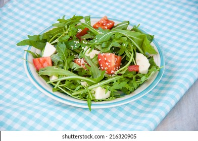 fresh salad with mozzarella, ruccola and tomatoes
