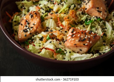 Fresh salad with napa cabbage, carrot, chicken, cilantro and sesame seeds