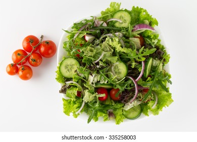 Fresh salad in a plate isolated on white background