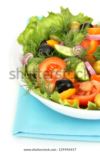 Fresh salad in plate isolated on white