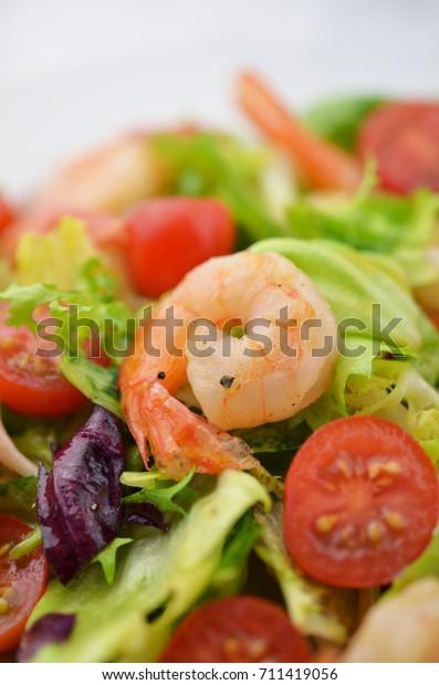 Fresh salad with prawns.