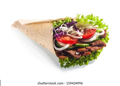 Fresh salad taco or tortilla wrap or doner with healthy lettuce, tomato, onion, cucumber and meat served for a quick takeaway snack at a restaurant, on a white background