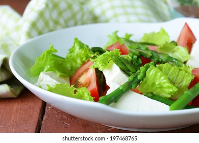 fresh salad with tomatoes, asparagus and cheese