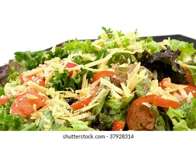 Fresh salad with tomatoes and cheese over white background