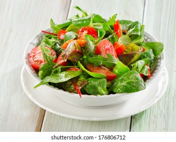 Fresh salad in a white bowl . Selective focus