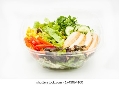 Fresh salads mix with grilled chicken fillet, cucumbers, sweet pepper and corn. Packed in a box, close-up on a white background - Shutterstock ID 1743064100