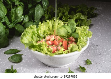 Fresh salat with tomatoes on rustic background