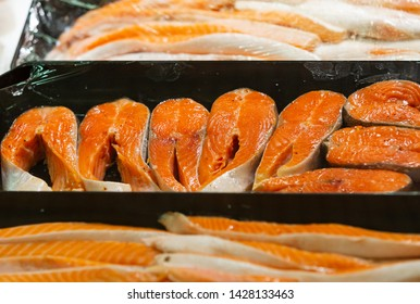 Fresh salmon fillet. Fish steak. Raw meat. Fish market. Smoked trout