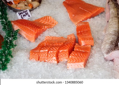 Fresh salmon fillet for sale at a market