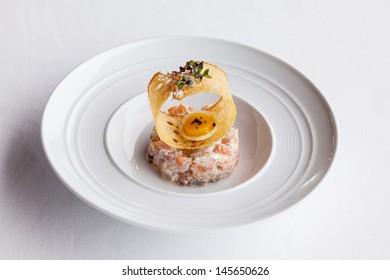 Fresh  salmon salad with tomato,caviar and crispy.