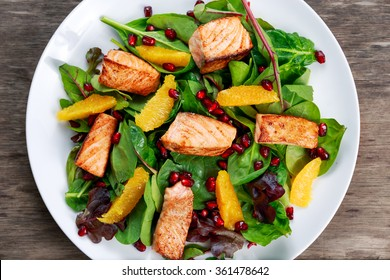 Fresh Salmon Salad with vegetables, pomegranate and orange