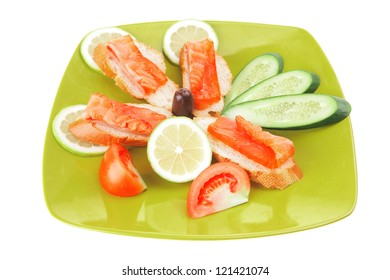 fresh salmon sandwiches and vegetables isolated on white